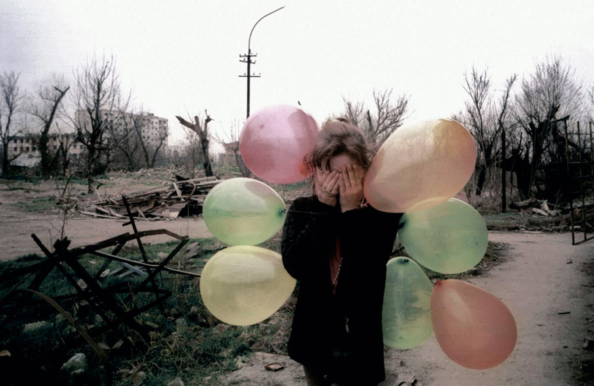 Girl with balloons. Chechnya. 2002.