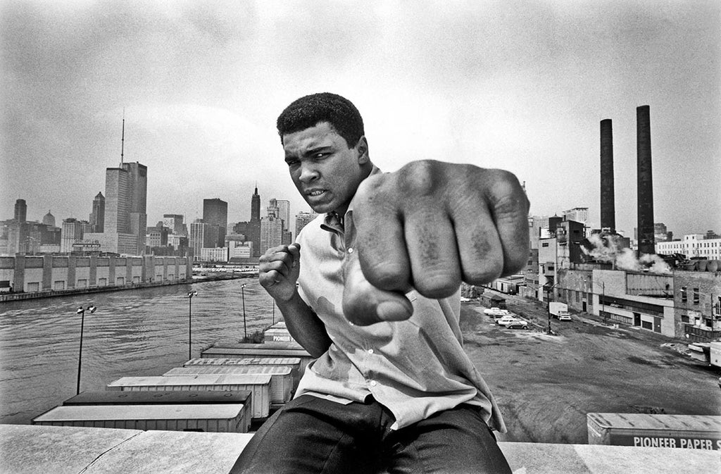 Muhammad Ali overlooking the Chicago River and the city's skyline. 1966.