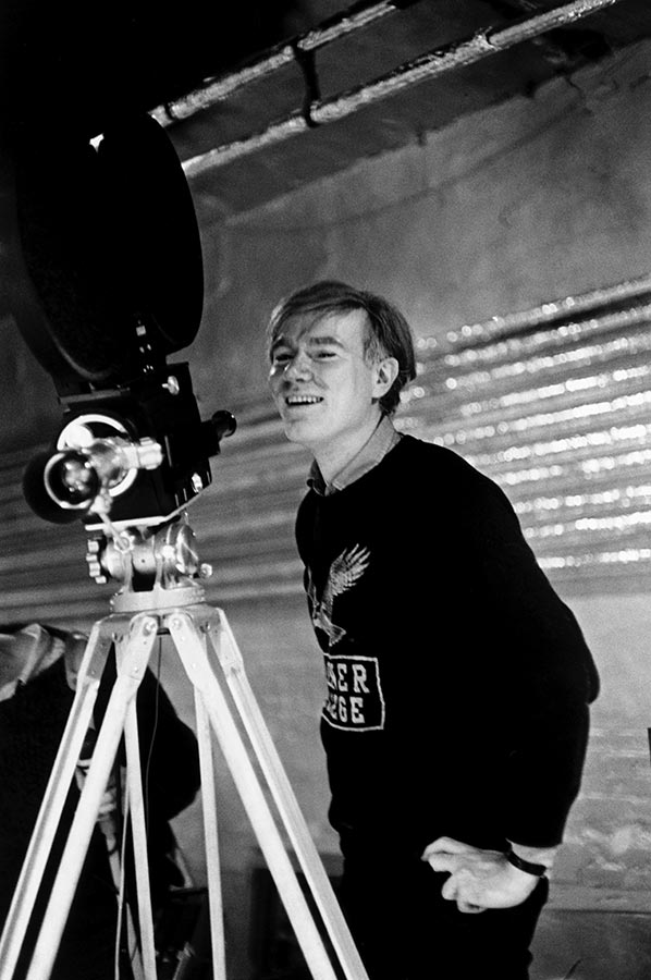 Andy Warhol at the Silver Factory with his first sophisticated anchored camera. New York City. 1964.