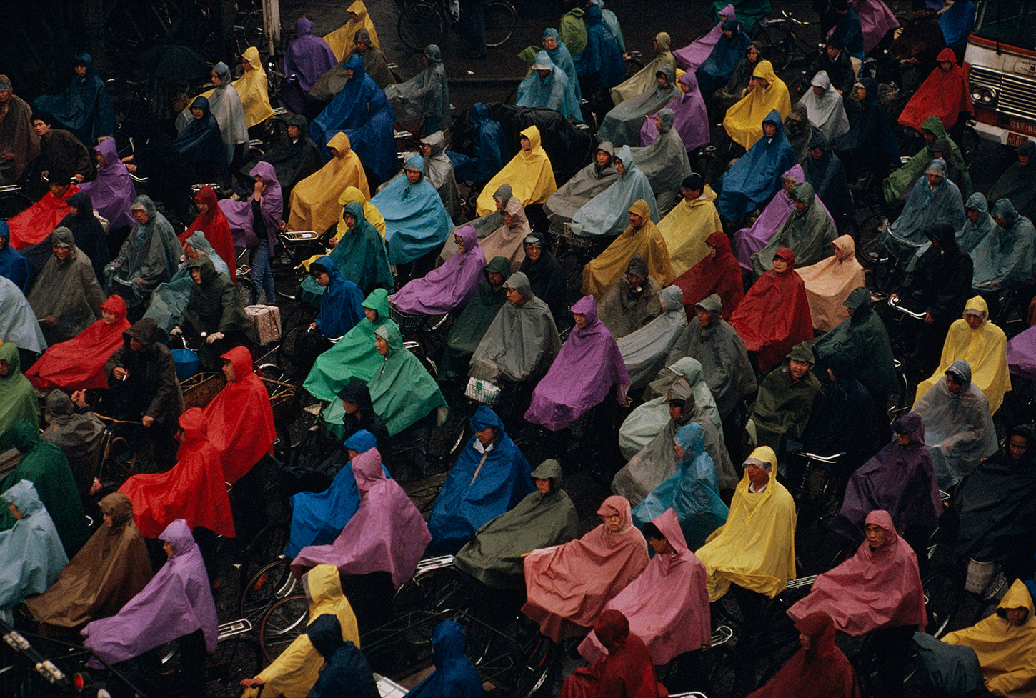 Cyclists in the rain. Shanghai, China. 1993