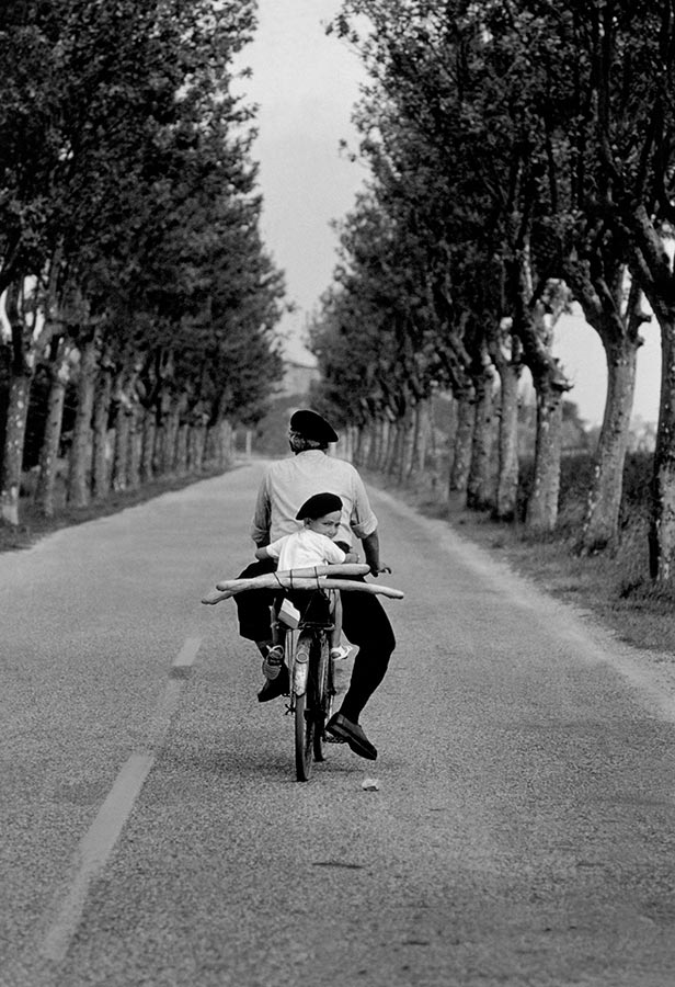 8. France. Provence. 1955. (Boy, bicycle & baguette)