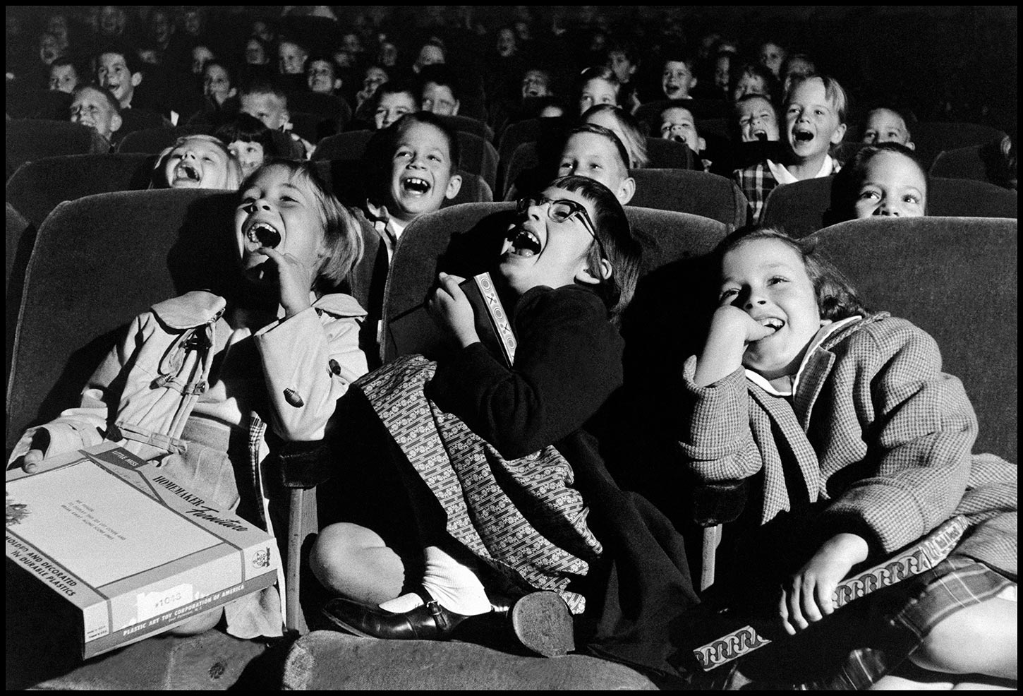 Children in a movie theater. USA. 1958.