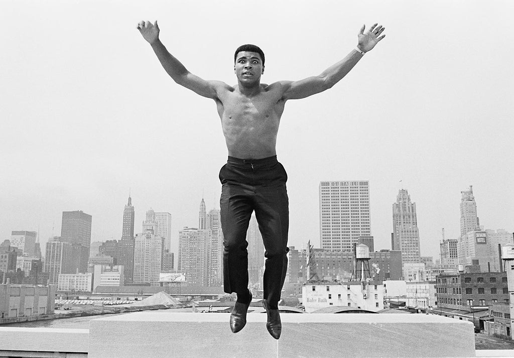 Muhammad Ali jumping over the Chicago River. 1966.
