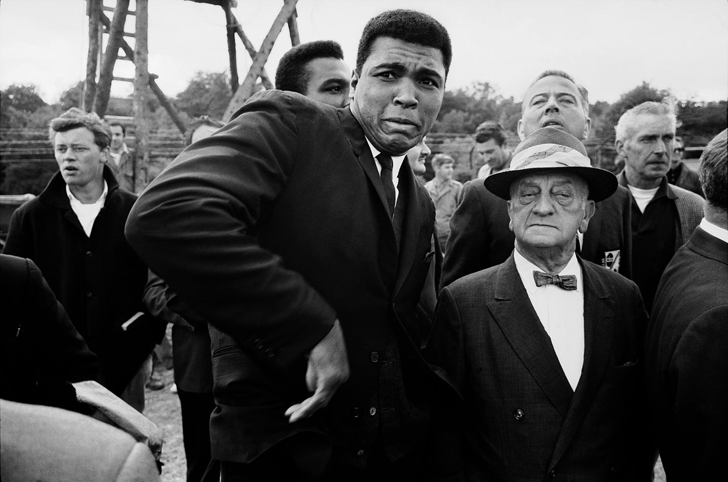 Muhammad Ali is scared by a bee while visiting a movie set in London. England. 1966.