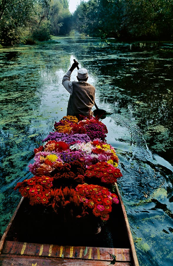 Flower seller at Dal Lake. Srinagar, India. 1999.