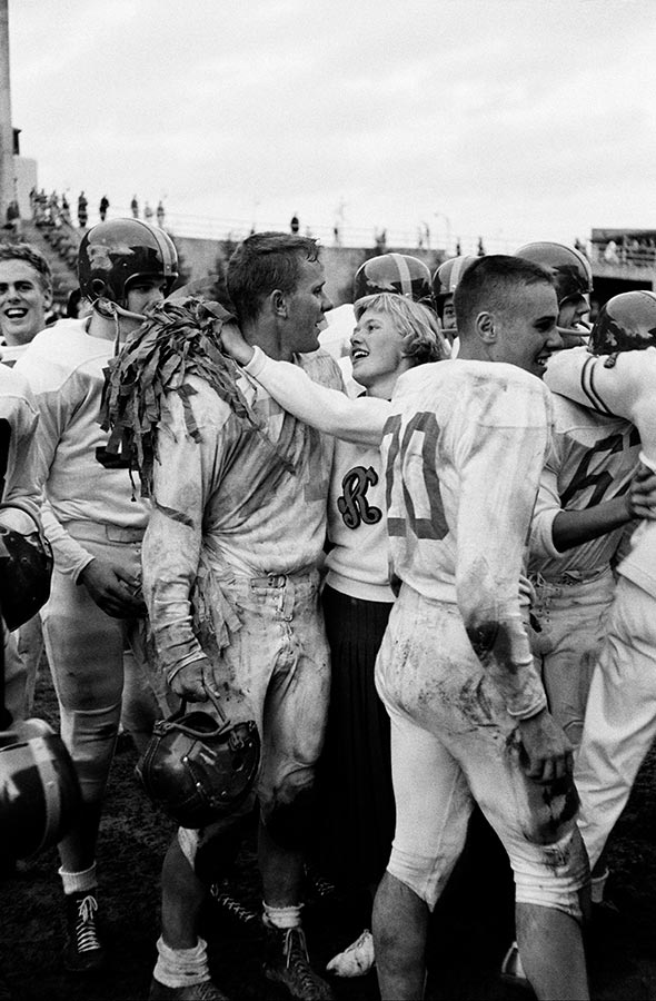 Head cheerleader and football captain embrace. Seattle, 1953.