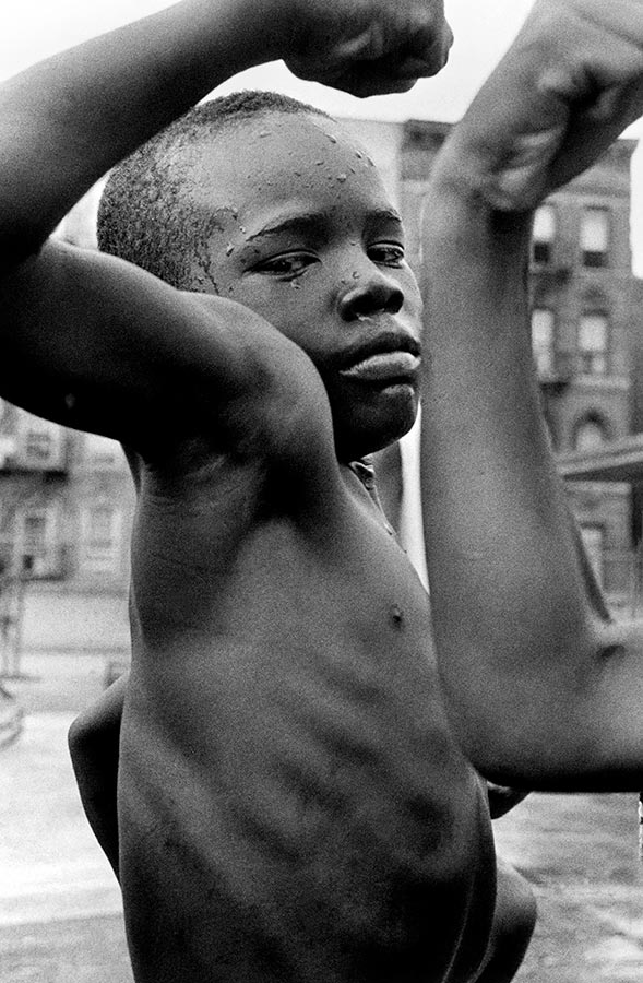 Young boy in the streets of Harlem. New York City, New York. 1963.