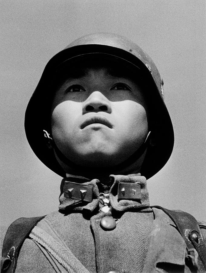 Boy soldier. Hankou, China. March 1938.