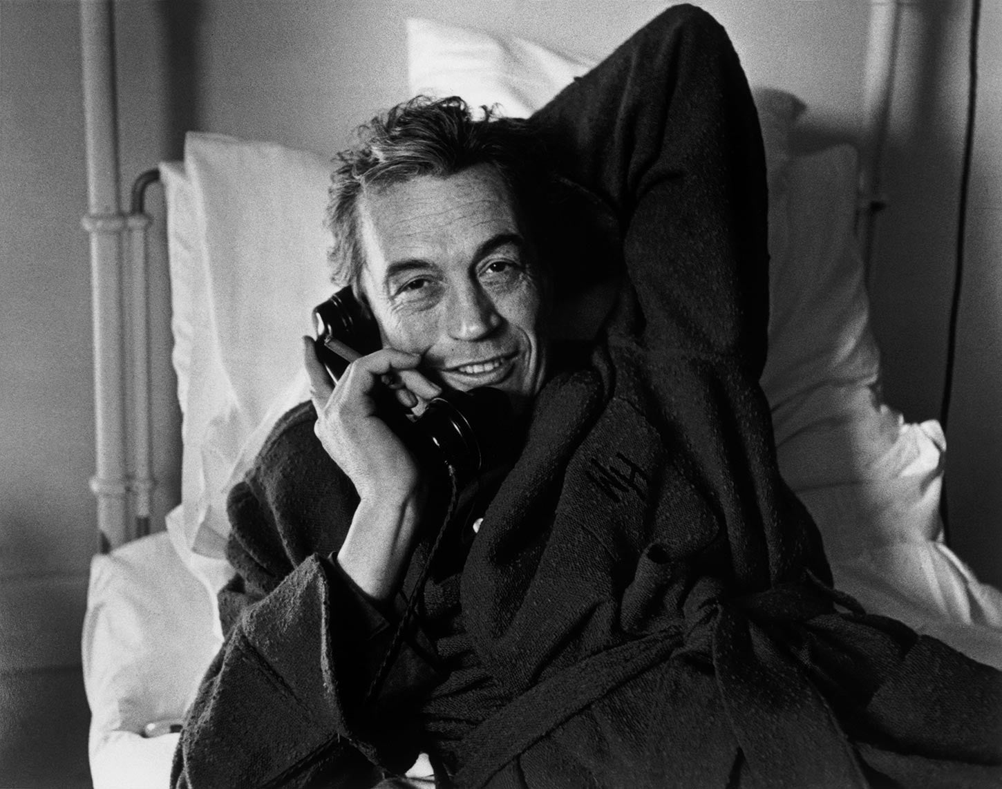John Huston talking on the phone. England. 1953.