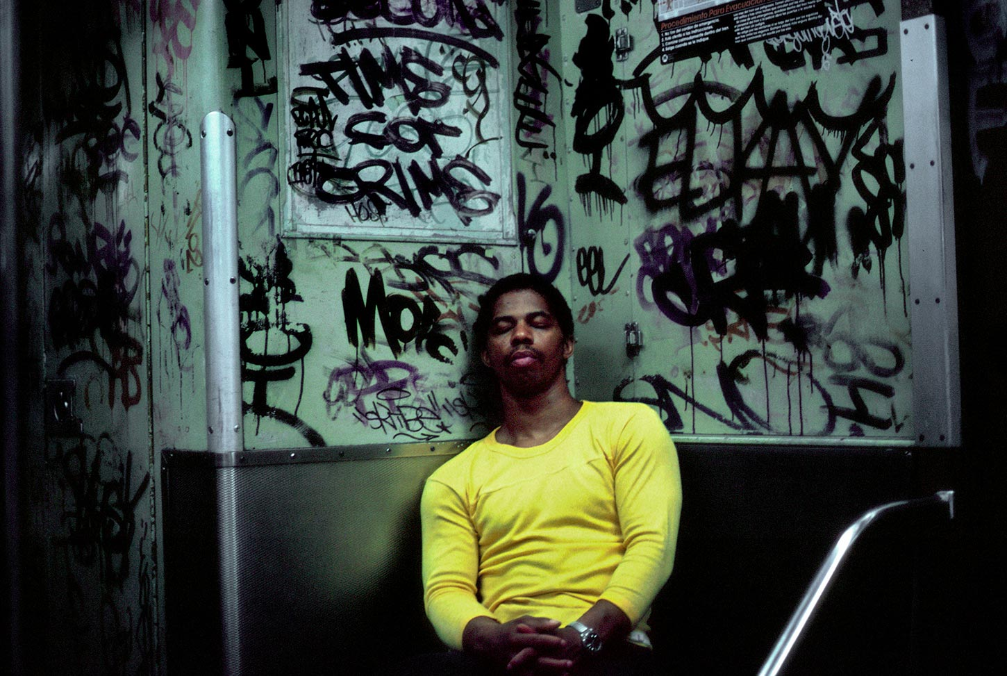 Young man in subway. USA. 1985.