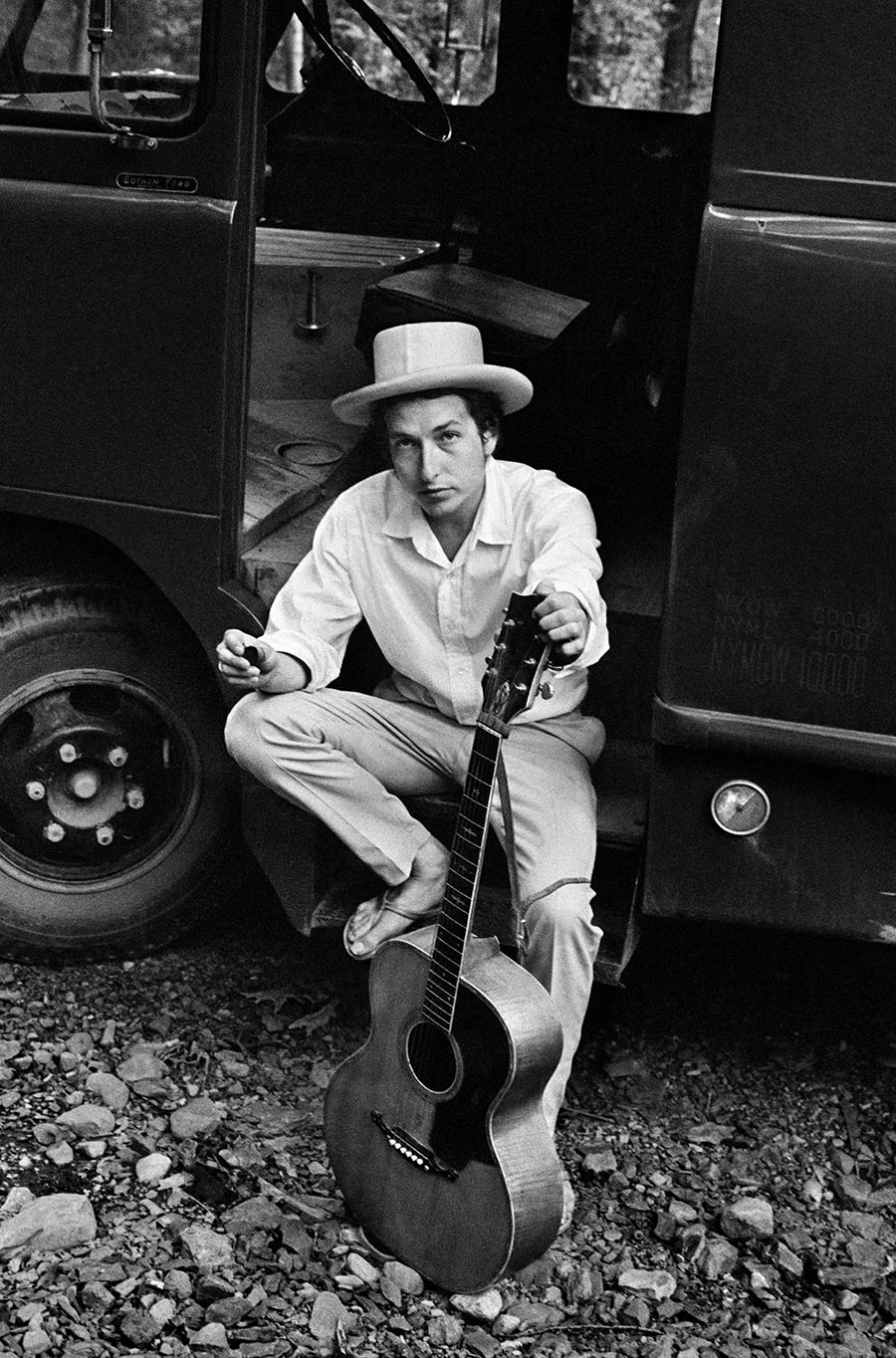 Bob Dylan on his equipment truck outside his Byrdcliffe home. Woodstock, New York. 1968.