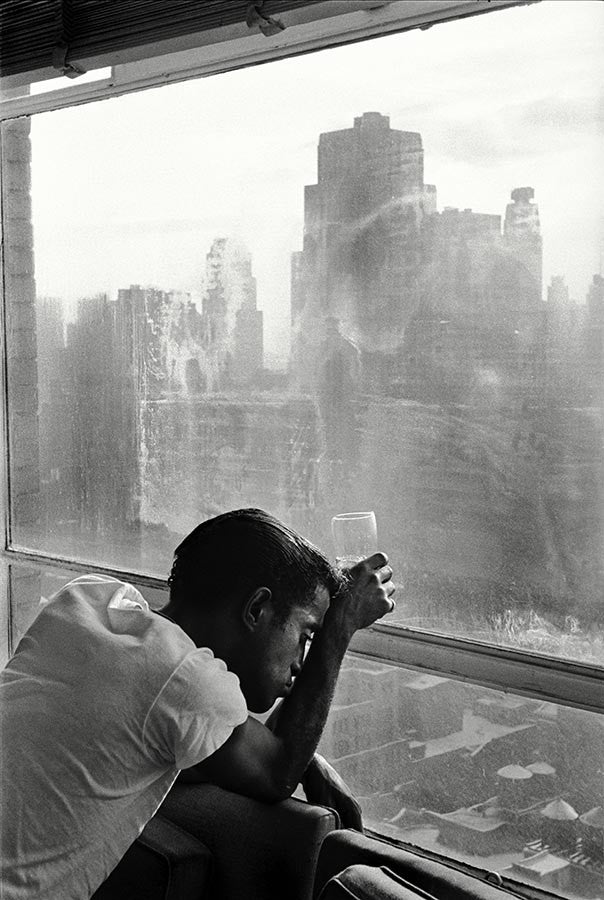 Sammy Davis Jr. looks out of a Manhattan window.  New York, 1959.