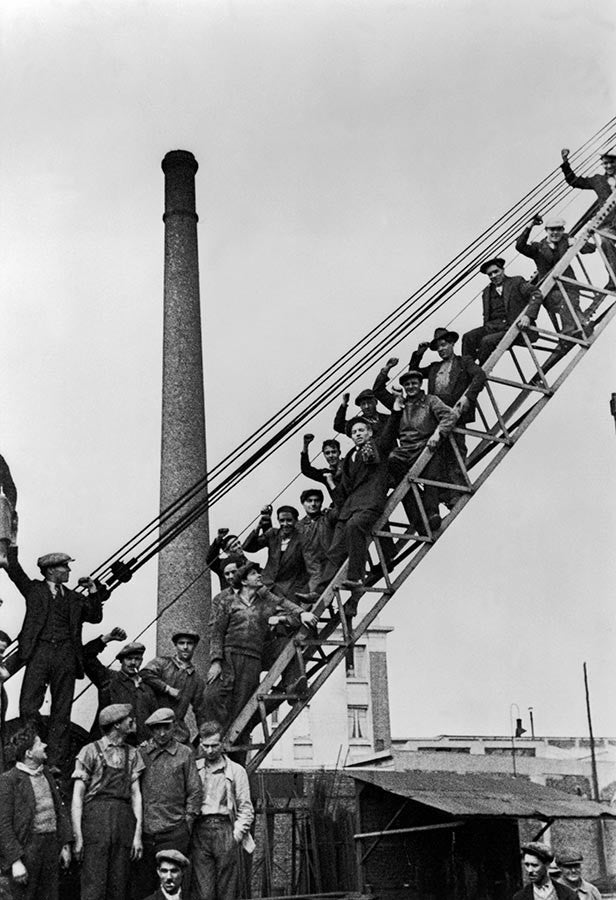 Workers in a steel factory protest. France, 1936.
