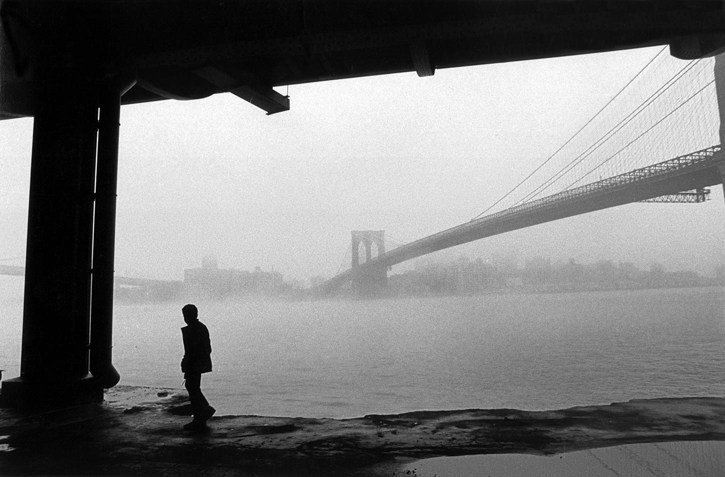Manhattan Bridge and Brooklyn Bridge in the fog. East River. New York City. 1986.