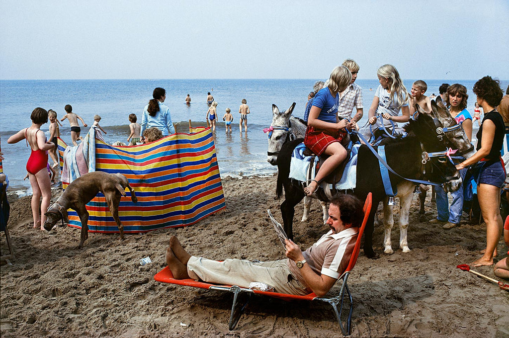 On the beach with dog and donkeys. From The Pleasure Principle. Blackpool, England. G.B. 1982.