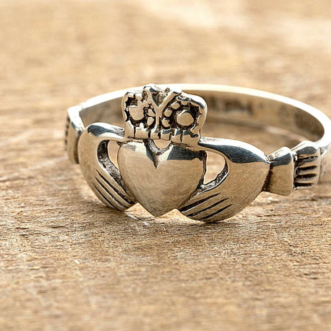Irish Claddagh ring hands clasping a crowned heart