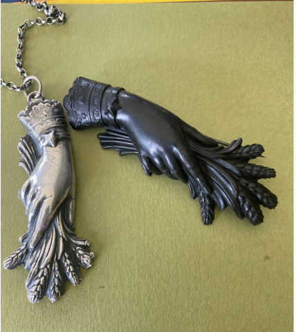 Modern silver cast pendant by irish shop swalkdesigns of a victorian mourning brooch with wheat in hand