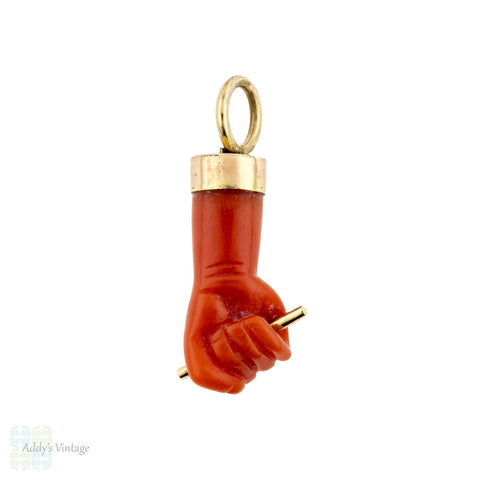 Orange coral hand clasping rod mano figa