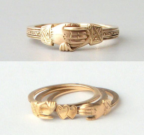 Gimmel ring that springs apart to reveal 2 hearts joined within