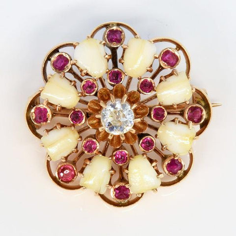 Victorian cushion brooch with baby teeth in radiating pattern