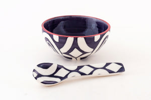 Small bowl and matching spoon in dark blue and white batik design.  Dishwasher and microwave safe.