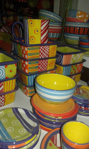 Selection of colorful hand made ceramics by Kapula. All are microwave and dishwasher safe. Fair Trade Gifts