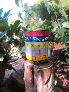Multicolored mug that can be used for a hot drink, or in the case a pot for  your favorite plant! Fair Trade Gifts