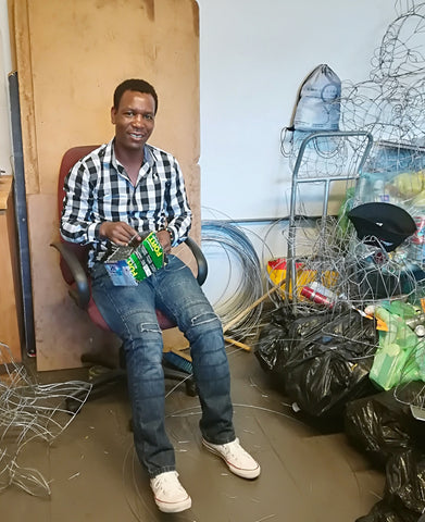 Philip at Godfrey's workshop making animals out of recycled materials #Blacklivesmatter