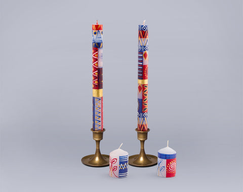 Red, white and blue taper candles and votive candles