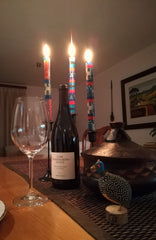 African Sky taper candles lighting up the dinner table!