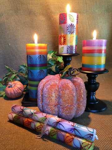 Burning candles in fall colors