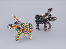 Happy Hippos handmade from recycled materials and beads.  Fair trade gifts.