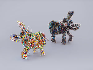 Happy Hippos handmade from recycled materials and beads.