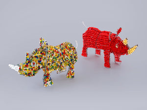 Rhinos made from recycled materials and beads. Save the Rhino!
