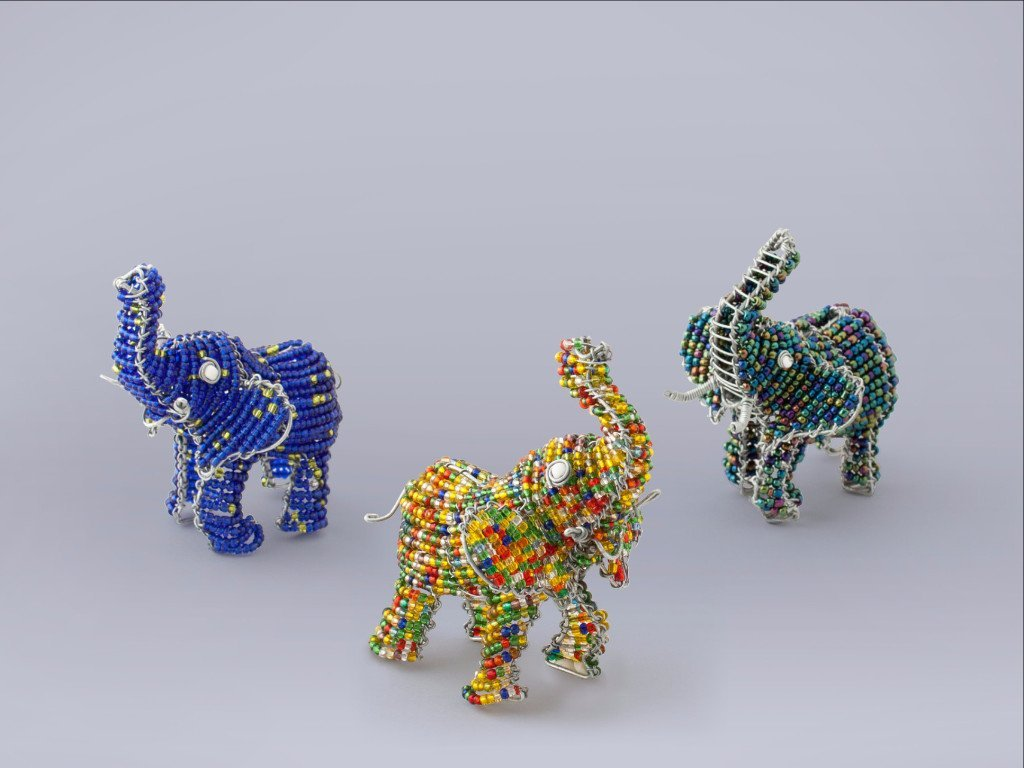 African Elephants handmade from recycled materials and beads.  The trunk is up for Good Luck!