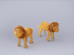 Lions handmade from recycled materials and beads.