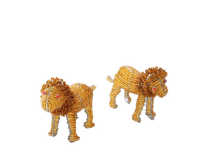 Two small beaded lion figurines. Made from recycled wire outline and beads strung throughout, of golden yellow and brown with a large whimsical mane. Red eyes.
