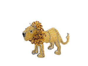 Beaded lion figurine. Made from recycled wire outline and beads strung throughout, of golden yellow and brown with a large whimsical mane. Fair Trade Decor. Fair Trade Gifts. Handmade Gifts. Handmade Decor. Handbeaded.
