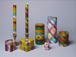 Magic Garden candles in green, blues, orange, and purple.  Hand poured and hand painted in South Africa.  Fair trade home decor.