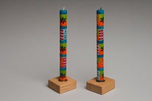Taper Candle Holders in golden stain hand crafted by Detroit artisans out of reclaimed wood, available in 3 colors.