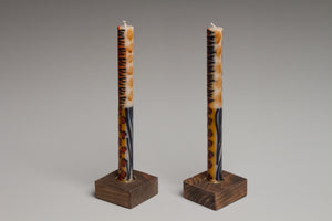 Taper Candle Holders in dark brown hand crafted by Detroit artisans out of reclaimed wood, available in 3 colors.