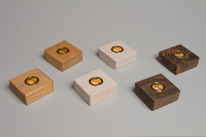 Taper Candle Holders hand crafted by Detroit artisans out of reclaimed wood, available in 3 colors.