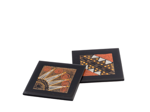 Black, silver, gold, and burnt orange wooden coasters hand crafted using recycled tea bags as the pallet for the African design painted inside design. Fair trade home decor.