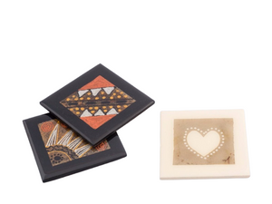 Wooden coasters hand crafted using recycled tea bags as the pallet for the painted inside design. Fair trade home decor.