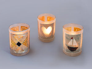 Tea light candles hand crafted using painted recycled teabags to make the designs