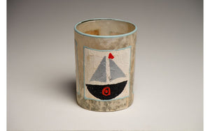 Tea light candles hand crafted using sail boats and light houses painted recycled teabags to make the designs. Fair trade home decor.