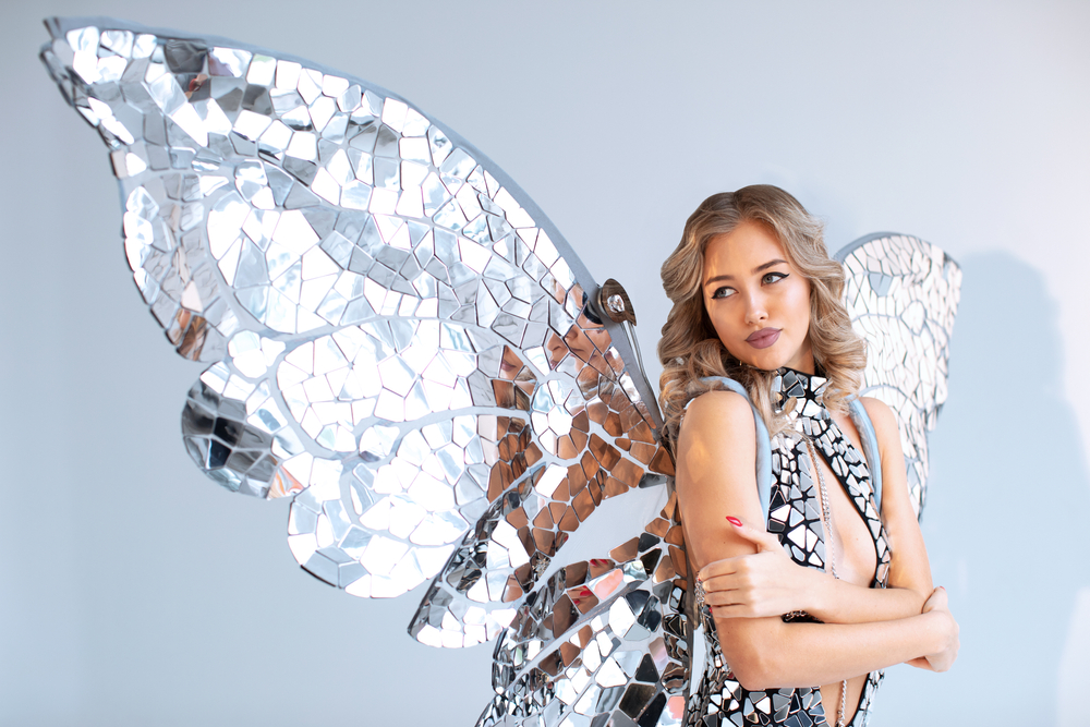 Blonde woman with mirrored angel wings