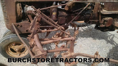 Farmall C tractor cultivator front left view