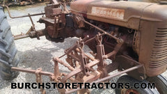 Farmall C tractor with cultivator 2 row