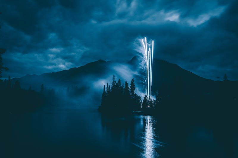 Photo by Andy Holmes showing fireworks on a dark blue sky